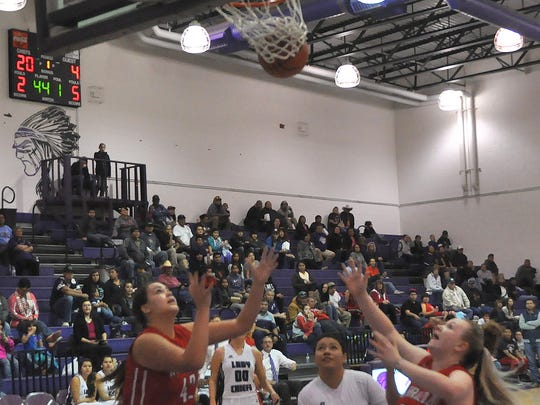 Mescalero and Carrizozo's girls scramble to the ball. The teams will play Thursday through Saturday at the Mescalero Basketball Classic.