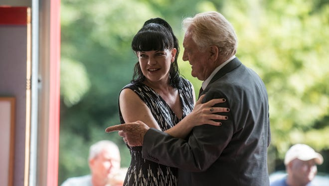 Pauley Perrette, star of CBS tv show NCIS, gets a hug from her father, Coosa County Commissioner Paul Perrett at the opening of the new Equality Fire Station on Saturday, Sept. 3, 2016.