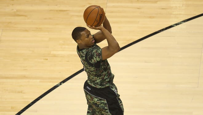 Toronto Raptors point guard Kyle Lowry (7) shoots and scores a basket against the Sacramento Kings at Air Canada Centre.
