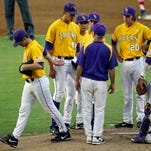 LSU pitcher Alden Cartwright, left, walks off the mound after being pulled with the bases loaded in the first inning of an NCAA college baseball regional tournament game against Houston in Baton Rouge.