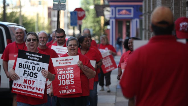 Verizon workers picket outside the company's Dispatch Resource Center in Wilmington last month. The contract between employees and Verizon expired Aug. 1.