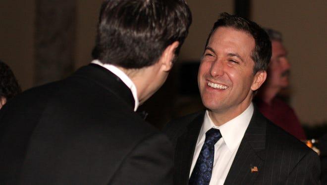 Former State Senator Dave Aronberg, right, mingles during the Lehigh Chamber of Commerce awards dinner in 2009.
