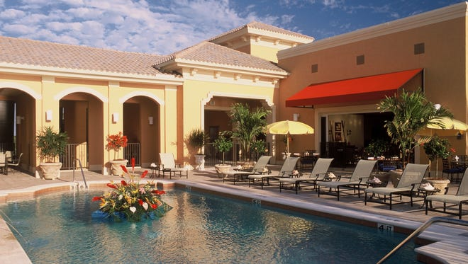 Situated on Little Hickory Island, the 10,000-square-foot Mediterra Beach Club is the highlight of the community's array of amenities.