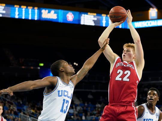 South Dakota Coyotes guard Tyler Peterson (22) attempts