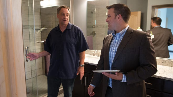 Realtor Kenny Kauzlarich, an Air Force veteran, shows a home to Michael Damerville of south Des Moines Wednesday, June 3, 2015, in Waukee. Iowa Realty has launched a program aimed at recruiting military veterans into the real estate business.
