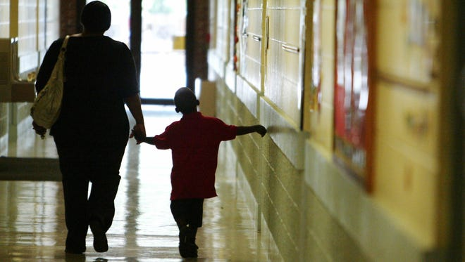A parent and student walk through Myrtle Place Elementary on the first day of school.