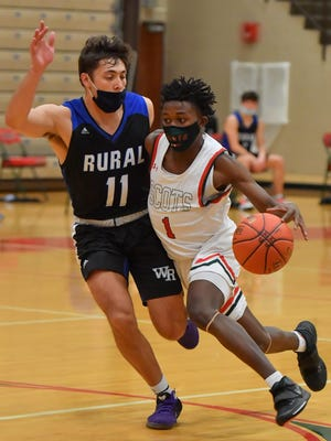 Highland Park's Jahi Peppers (1) drives past Washburn Rural's Joe Berry (11) during Friday night's Centennial League game. Peppers scored 12 points to help the Scots to a 51-48 win.