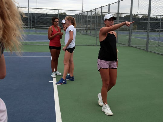 Palm Desert High School tennis coach Morgan McIntosh works with her team on Wednesday, September 21, 2016 in Palm Desert.