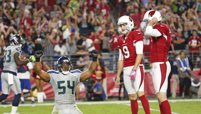 Seattle Seahawks middle linebacker Bobby Wagner (54) raise his arms after Arizona Cardinals kicker Chandler Catanzaro (7) missed a game-winning field goal in overtime at University of Phoenix Stadium in Glendale, Ariz. October 23, 2016. The game ended in a 6-6 tie.