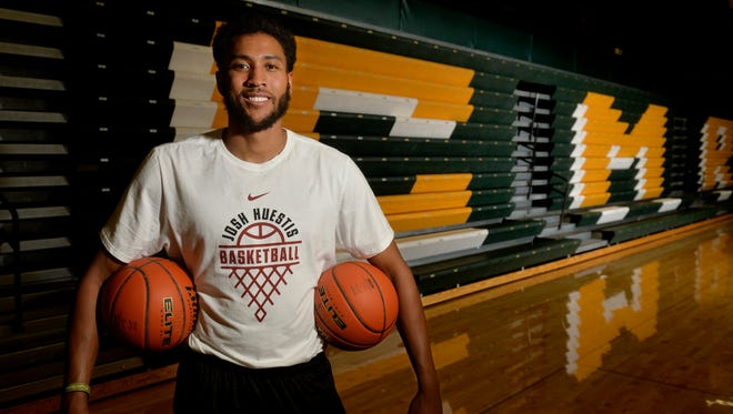 Josh Huestis was in Great Falls for a basketball camp in July. The C.M. Russell High graduate last month suffered a fractured foot, but Tuesday signed a contract with the San Antonio Spurs.