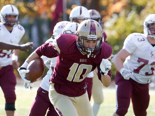 Iona Prep's Michael DeGasperis finds a path against Fordham Prep in the quarterfinals of the Catholic High School Football League Nov. 6, 2016 at Iona Prep in New Rochelle. Iona Prep won, 41-0.