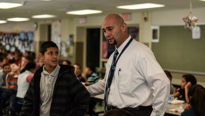 Pedro Cruz, principal at Henry Houck Elementary School in  Lebanon, checks on students during their lunch time on Monday, January 11, 2016. Representatives of local educational institutions say that the quality of an educator does not turn on his or her race.