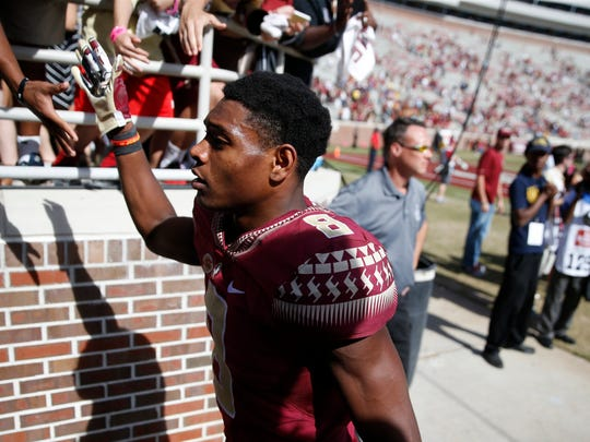 FSU's Jalen Ramsey walks off the field at Doak Campbell after beating Louisville 41-21 on Saturday.