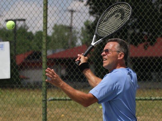 Ontario boys and girls tennis coach Tim Babock played