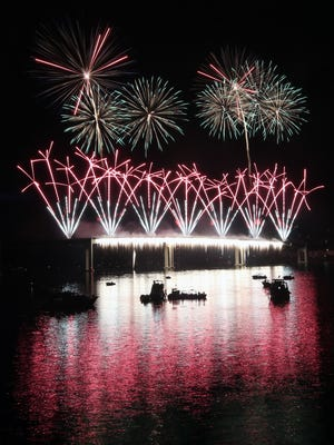 Fireworks from the Manette Bridge light up the sky during the Bremerton Bridge Blast on Saturday, June 30, 2018.