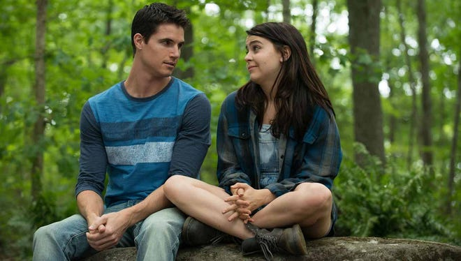 """Wesley (Robbie Amell) helps Bianca (Mae Whitman) feel comfortable in her own skin in """"The DUFF."""""""