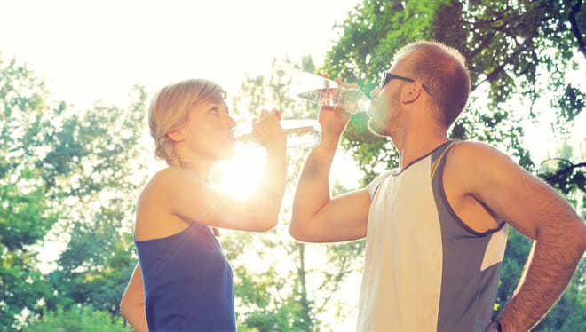 Couple doing some exercise/running/jogging in the park.
