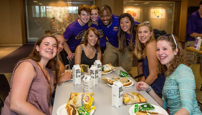 New students at the University of Wisconsin-Stevens Point are joined by members of the Cheer and Stunt team during a Welcome Week lunch at the Dreyfus University Center last fall.