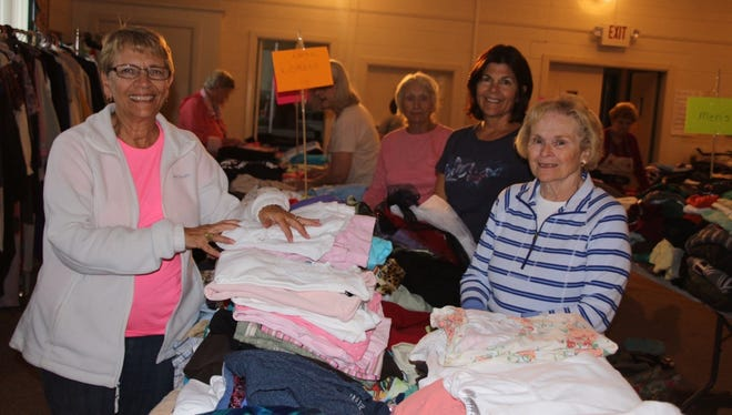 (From left) Barbara Westog, event co-chair, Irene Bird, club member; Claudia Rempfer, co-chair; and  Sheila Veale, club member, at the Millville Woman's Club's recent rummage sale. Louise Jones, also an event co-chair, is not pictured.