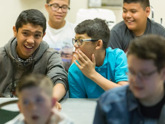 Jose Ramirez, 13, left, and his brother Ismael Ramirez, 11, attend a spring break camp about forensic science on Monday, March 20, 2017, at the Museum of Nature & Science.