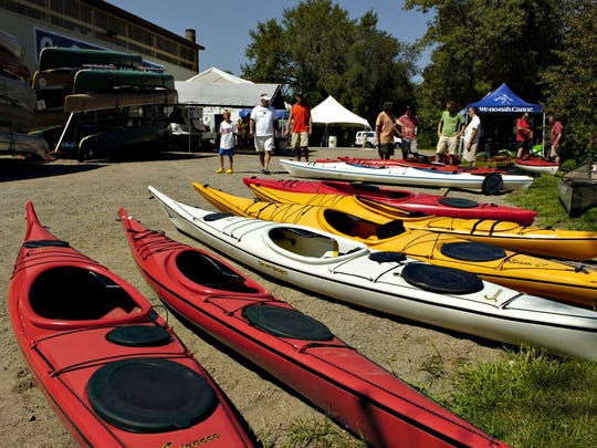 Kayaks and canoes are on display and available to test in the Mississippi River at Clear Waters Outfitting Company in Clearwater in this 2014 photo.