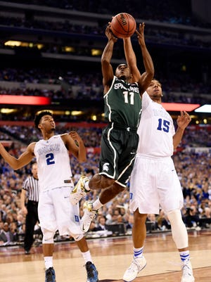 Michigan State's Lourawls Nairn Jr. tries to shoot between Duke's Jahlil Okafor (15) and guard Quinn Cook (2).