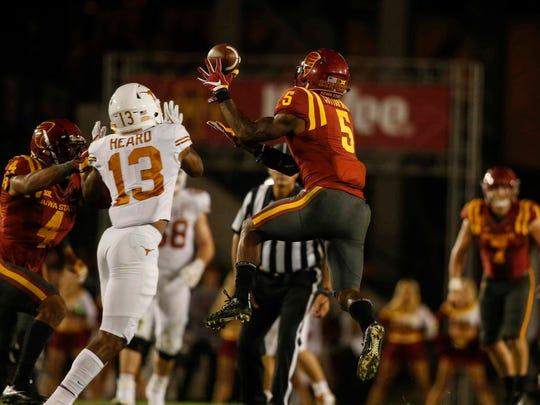 Iowa State safety Kamari Cotton-Moya intercepts a pass