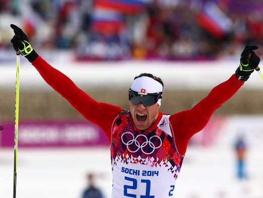 Dario Cologna (SUI) reacts at the finish line after winning the men's skiathlonduring the Sochi 2014 Olympic Winter Games at Laura Cross-Country Ski and Biathlon Center.