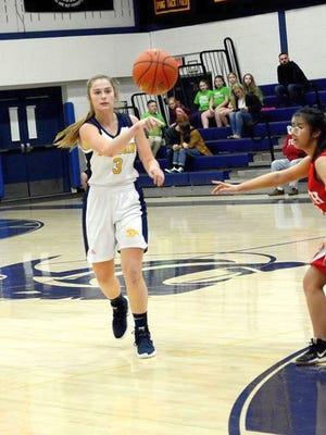 Quabbin senior Olivia Fay, left, plans to study international business and logistics and play basketball at Maine Maritime Academy next school year.