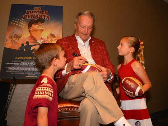 The Brevard Seminole Club presented The Bowden Dynasty film with special guest legendary FSU coach Bobby Bowden at the Kennedy Space Center Visitor Complex Friday night. At a VIP reception, people waited in line to meet the coach and get a photograph taken with him.  Future Seminoles Austin and Malina Levesque have Coach Bowden autograph a football.