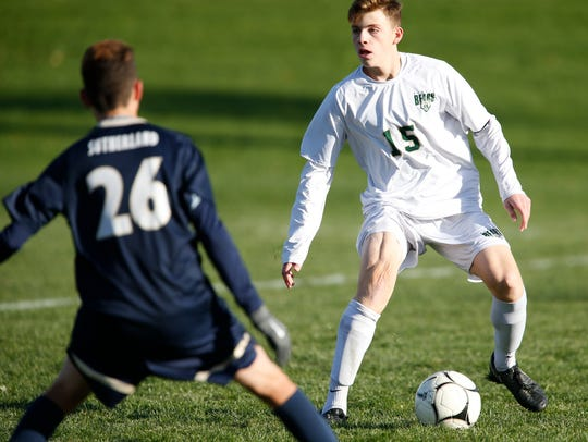 Vestal's Carter Beaulieu looks to pass the ball past
