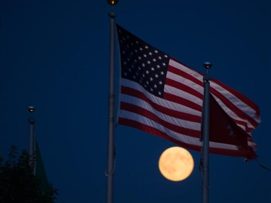 The flag and the moon in Oregon. Fifty years, we placed a flag on the moon.