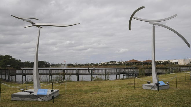 A pair of kinetic sculptures by Jeff Kahn move in the wind during The Art of Sustainability at Eastern Florida State College in Palm Bay.