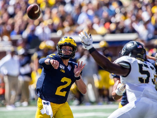 Shea Patterson throws a pass in the second quarter against Army.