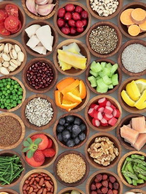 Super food diet selection in wooden bowls. High in antioxidants, vitamins, minerals and anthocyanins.