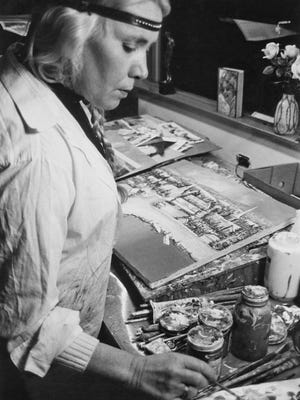 Ellen Topelmann, who passed away Aug. 1 at age 90, is shown at work on a painting in her studio.