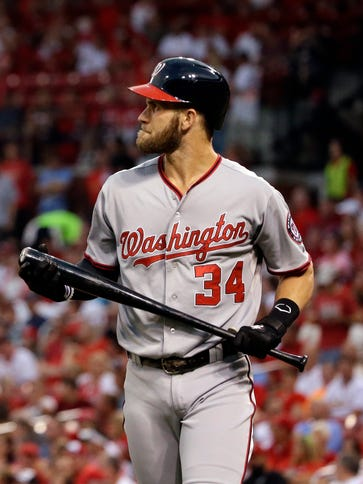 Bryce Harper heads back to the dugout after striking