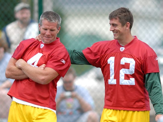 Brett Favre and Aaron Rodgers joke around during a 2006 practice.