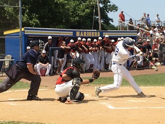 Junior second baseman Ben Pampush makes contact in