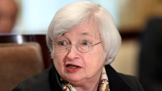 Federal Reserve Chairwoman Janet Yellen speaks during a meeting of the Board of Governors of the Federal Reserve System at the Federal Reserve in Washington, Wednesday, Oct. 22, 2014.
