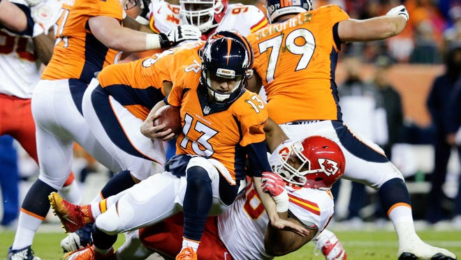 Nov 27, 2016; Denver, CO, USA; Kansas City Chiefs defensive tackle Kendall Reyes (98) sacks Denver Broncos quarterback Trevor Siemian (13) in the second quarter at Sports Authority Field at Mile High.