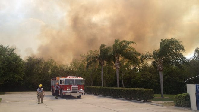 Rockledge and Brevard County firefighters are battling a small brush fire east of Murrell Road and south of Commerce Parkway.