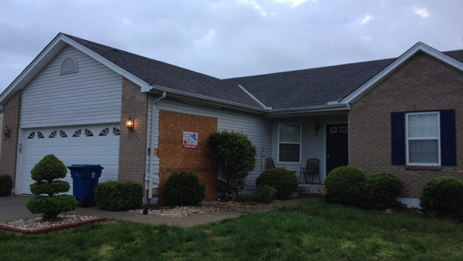 A Fairfield Township house is boarded up after a  vehicle crashed into it early Wednesday.