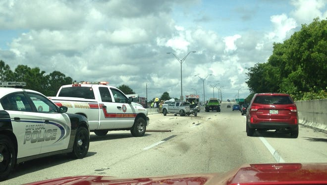 One vehicle involved in the crash on Veterans Parkway bridge can be seen in the left lane.