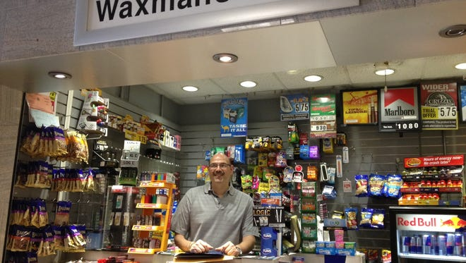 Gary Waxman worked his last day at the White Plains train station newsstand on Friday. Gateway Foods will run the newsstand.