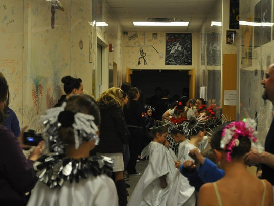 A group of dancer's prepares to take the stage.