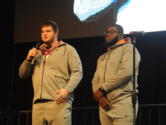 Florida State's Dervin Taylor II and Landon Dickerson
