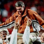 1998: Texas head football coach Mack Brown is carried off the field by his players after their 20-16 upset win over Nebraska in Lincoln, Neb.