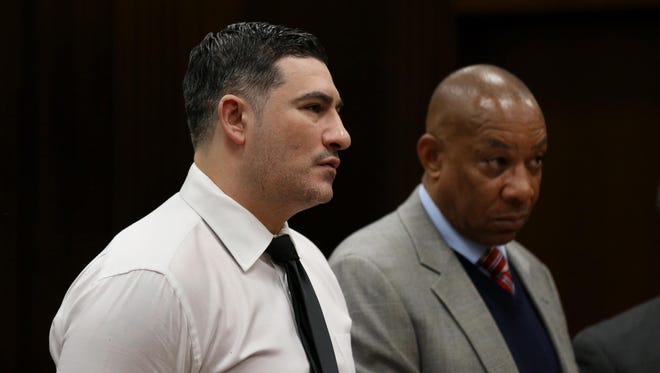 Bassel Saad, 36, stands before Judge Timothy Kenny (not seen) with his attorney Cyrill Hall as he enters a plea of guilty or no contest to involuntary manslaughter during a hearing on Friday, February 20, 2015 at theFrank Murphy Hall of Justice in Detroit.  Saad,, is charged with second-degree murder in the death of 44-year-old John Bieniewicz last summer.