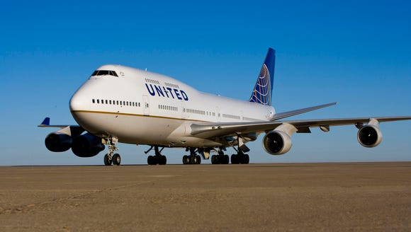 A United Airlines Boeing 747 is shown at Chicago O'Hare